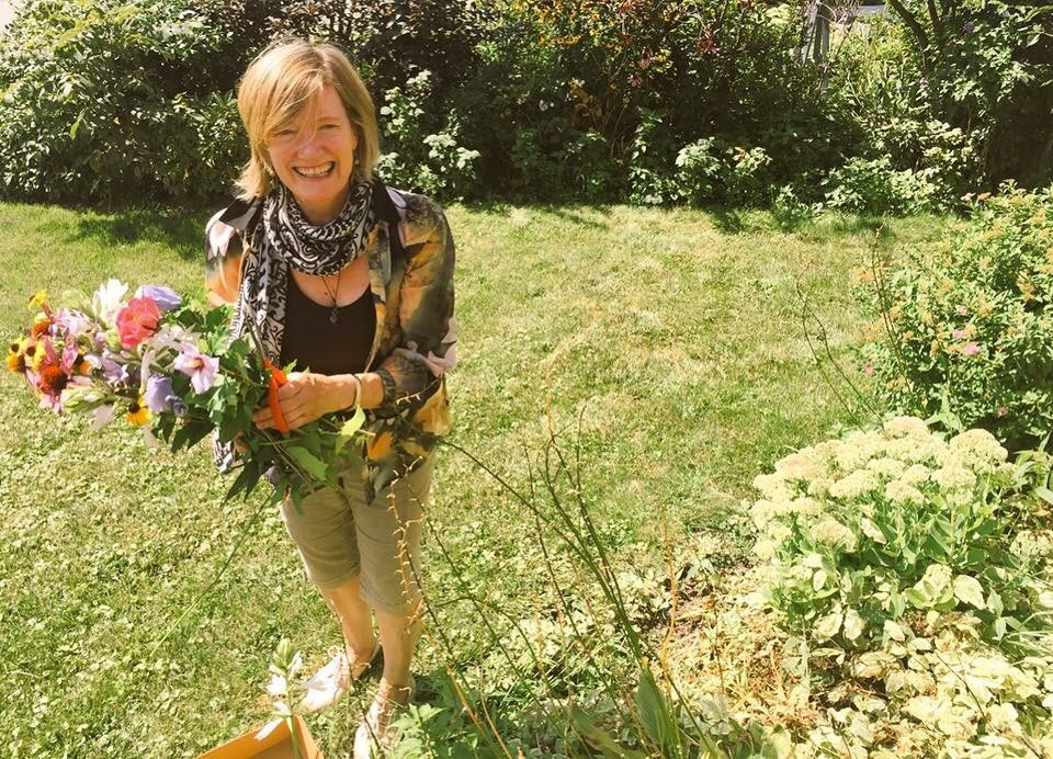 mum picking flowers for me in her garden