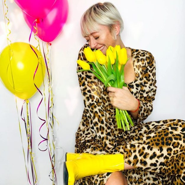 Casie Stewart, pink and yellow balloons, spring flowers, leopard dress, having fun.